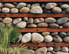 """One of Levine's design experiments is this """"thermal rock wall"""" of loosely stacked stones."""