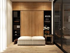 The shelves in this space are so chic. We love the dark wood contrasted against the honey colored wood of the murphy bed.