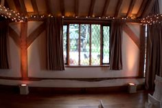 Uplighting and fairy lights for a warm autumn wedding at Cain Manor