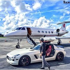 """All white Mercedes SLS AMG & private jet. Fly wherever you want! I see hard work, success and sleepless nights. Jets Privés De Luxe, Luxury Jets, Luxury Private Jets, Private Plane, Rich Lifestyle, Luxury Lifestyle, Luxury Blog, Jet Privé, Mercedez Benz"