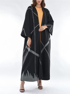 Black designer Bisht-style Abaya featuring an intricate contrast embroidery in geometric pattern. The black Abaya by posh comes with shila. Arab Fashion, Muslim Fashion, Modest Fashion, Fashion Dresses, Saree Embroidery Design, Gap Outfits, Mode Abaya, Stitching Dresses, Abaya Designs