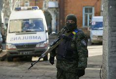 An armed Ukrainian soldier guards access to a hospital in Artemivsk, February 18, 2015. REUTERS-Gleb Garanich