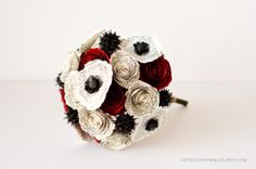 Bridal book page bouquet with red and ivory roses, ivory/black poppies and black sweet gum pods