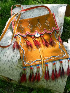 Dark gold painted and beaded leather shoulder bag by hfmade, Monica Alexander, Métis on Etsy