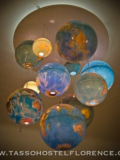 Up-cycled globe chandelier by Phillipe :) would be cute for office or little boys room!!