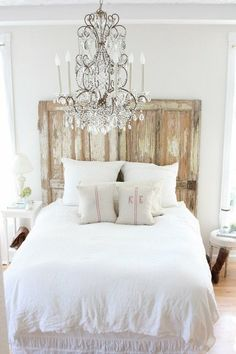 Great mix of textures: wood headboard, crystal chandelier & burlap pillows