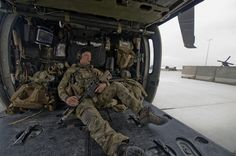 "An Air Force Pararescue Jumper sits in his aircraft awaiting a mission. The PJs are tasked with the recovery of injured personnel in hostile environments and are trained in emergency medical treatment procedures. Their motto is ""That others may live."""