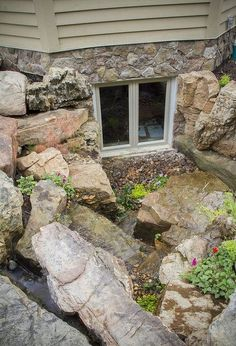 waterfalls for window wells, outdoor living, ponds water features, window treatments, windows, A mix of plants and rock was used to provide a fantastic view