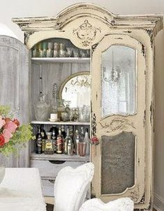 This armoire was repurposed into a wet bar for a dining area.   It could also be turned into a wine bar, linen or guest closet full of everything your guests would need during their visit.