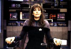 Troi in command! Marina Sirtis takes a seat in the captain's chair in ST: Nemesis, 2002.