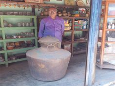 Mr.Muralidharan with antique brass pot  Kindaram in the antique shop at Karaikudi