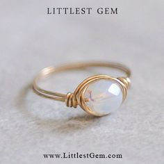 Hey, I found this really awesome Etsy listing at https://www.etsy.com/listing/177515175/white-opal-ring-wire-wrapped-ring-wire
