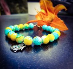 Check out this item in my Etsy shop https://www.etsy.com/listing/258956799/blue-and-yellow-beaded-bracelet-with