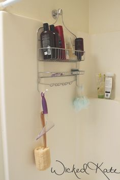 put shower organizer on wall ACROSS from faucet on a robe hook! More room to wash, less scum on the organizer! win-win!