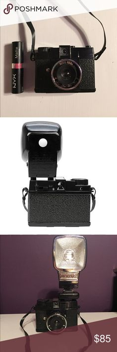 """Diana Mini Lomography Camera - Petit Noir The Diana mini takes any standard 35 mm film whether black and white, color negative and transparency. Comes complete with flash for nighttime photography. Takes multiple and long exposures. Standard film development. There are different frame formats rectangular """"half-frames"""" which are 17x24 mm, or square 24x24 mm. Half frames take 72 shots on a 35mm roll while square produce 36. Also included are instructions. Only used a few times, in very good…"""