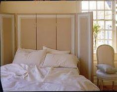 Biombo como cabecero de cama. Una buena solución
