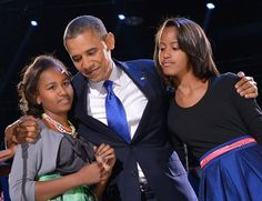 Re-elected U. President Barack Obama hugs his daughters Sasha (L) and Malia (R) on election night Tuesday. Barack Obama, Malia Obama, Obama Daughter, First Daughter, Malia And Sasha, Election Night, 2012 Election, Black Fathers, Sons