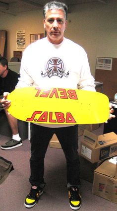 steve alba with a bevel skate deck
