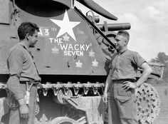 """Gun crew with the Priest M-7 self-propelled gun A3 """"The Wacky Seven"""" of the 19th Field Regiment, Royal Canadian Artillery (R.C.A.), France, July 1944. (item 1)"""