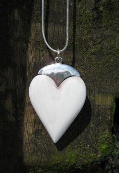 long heart pendant necklace.. £25 www.danielli.co.uk