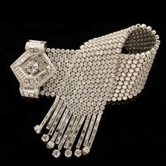 Paris, circa 1935.Stunning diamond buckle bracelet: Hancocks, London.
