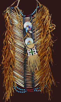 This is an American Indian breast plate, materials used through-out is bone hairpipe, leather breastplate strips, different colors of crow beads, sinew and leather lacing. It was invented in Native American Regalia, Native American Clothing, Native American Beauty, Native American Photos, Native American Crafts, Native American Artifacts, American Indian Art, Native American History, Native Indian
