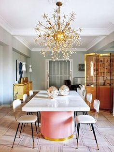 Living-Pink-Madrid-apt-glam-dining-room-table-by-Patricia-Bustos-brass-flower-chandlier
