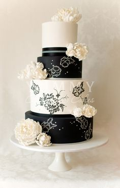 Black And Cream Tiers of Hand Painted Flowers Cake
