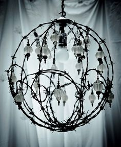 barbwire chandelier. BUT WITH JUST ONE MAIN BULB MUST GET DAD TO MAKE!!!! Metal Crafts, Diy Arts And Crafts, Barb Wire Crafts, Wire Chandelier, Chandeliers, Lampshades, Rusty Garden, Chicken Wire Art, Barbed Wire Art