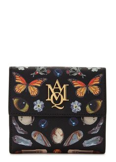 Alexander McQueen black grained leather wallet Obsession print, designer plaque, two compartments, ten internal card slots, two note sections, two slip pockets, fully lined Concealed press stud fastenings at tab and flap front Presented in a designer-stamped box