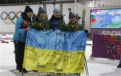 Ukraine's relay team Vita Semerenko, Juliya Dzhyma, Olena Pidhrushna and Valj Semerenko, from left, celebrate with Ukrainian flag with writings on it after winning the gold during the flower ceremony of the women's biathlon 4x6k relay at the 2014 Winter Olympics, (AP Photo/Kirsty Wigglesworth) ▼21Feb2014 AP|Ukraine wins women's biathlon relay for 1st gold http://wintergames.ap.org/article/ukraine-wins-womens-biathlon-relay-1st-gold  #sochi2014 #Biathlon #Womens4x6kmRelay #ukraine #ucrania