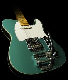 Google Image Result for http://www.themusiczoo.com/images/5-24-10/Telecaster_Bigsby_Teal_F0300269_1.jpg
