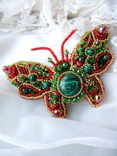 Bead embroidered bug with malachite, red green. $97.00, via Etsy.