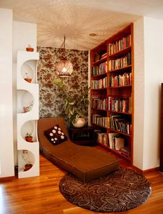 floor to ceiling books and a comfy chair...what more do you need?