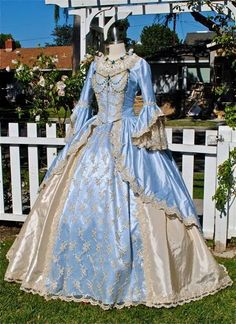 The dress is made of silk fabric which is bright in colour