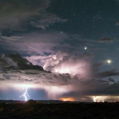 A powerful storm hammers the landscape around Utah's Arches National Park. Astrophotographer David Lane captured this striking shot of multiple lightning strikes. Venus (brightest lower right) and Jupiter (middle) are visible while the blue star Regulus (upper left) is shrouded in a bit of clouds. Photo courtesy of David Lane.