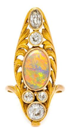 An Art Nouveau Yellow Gold, Opal and Diamond Ring, in a sculpted openwork asymmetric setting containing one oval cabochon cut white opal m Opal Jewelry, Jewelry Art, Antique Jewelry, Gold Jewelry, Vintage Jewelry, Fine Jewelry, Antique Art, Jewellery, Art Nouveau Ring