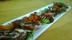Rotolini di bresaola con stracchino e verdure. Meat rolls with cheese and vegetables.