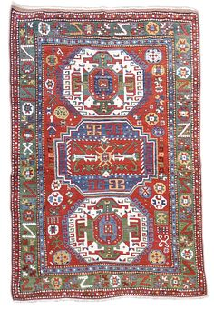"""Kazak, 19th C (4th Q),  Caucasus - This bold & colorful Kazak paints a column of three alternating medallions against a vibrant madder-red field. A balanced use of white accentuates the sense of color. In classic Caucasian style, a host of traditional village ornament sparkle throughout, including several geometric forms, a highly stylized animal & even a human figure in the upper right-hand side. The red field is complimented by an elegant & modulated green border... W: 5' 6"""" x L: 7' 10"""""""
