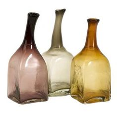 A delightful addition to your console, mantel, or desk, this charming set of accents is an eye-catching addition to your d�cor.    Product: 3 Piece bottle d�cor setConstruction Material: GlassColor: Amber, gray, and mauveDimensions: 10.25 H x 4 W x 4 D each