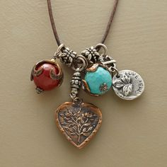 """LOVE CHARMS NECKLACE--Two white bronze charms speak out for love while sharing this love charms necklace's brown leather cord with two bright beads, a faceted carnelian and a turquoise-blue magnesite. Handmade in USA. Exclusive. Approx. 36""""L."""