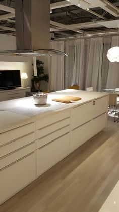 Modern white IKEA kitchen with white worktops and