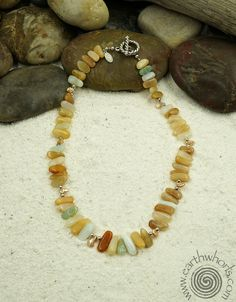 Peruvian opal, pearl and sterling silver necklace by EarthWhorls.  https://earthwhorls.com/collections/necklaces/products/1101sn  One of a kind, handmade, free shipping in time for Valentine's Day!