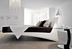 a seeming floating bed (legs are behind the coverlet)