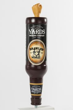"""The Yards Bottle Tap"" – Chris Dietrich. How do customers recognize Yards Beer in a poorly lit bar? This design mimics the strengths of the Yards brand in the commercial bottle market and extends that recognition to the draft point-of-purchase moment With prominent 360° Yards branding and a flavor label on the customer AND pourer sides, this universal tap retains the core brand across all flavors. Top-mounted figures emphasize the iconic styles and add unique character to the Yards product line."