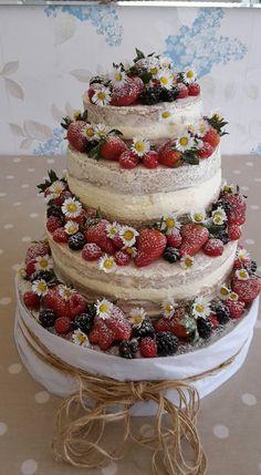 Naked wedding cake daisies blackberries raspberries strawberries