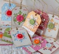 Love these Christmas Tags made with buttons and snowflake punch.
