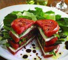 Stack tomatoes, some mozzarella cheese and asparagus and drizzle with some balsamic vinaigrette..