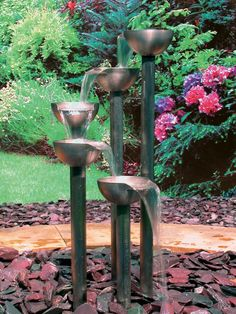 Outdoor Ponds, Water Features and Water Gardens: The Aquafires Stainless Steel Tier Five Fountain from Wayfair fits in gardens of all sizes.  The effect of the water flowing from cup to cup and then disappearing is pleasing to watch.  From DIYnetwork.com