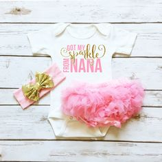 Got My Sparkle From Nana Baby Girl Onesie with Chiffon Ruffled Pink Tutu Diaper Cover Bloomers add the matching pink and gold sequin messy bow to complete the outfit. Browse our entire collection of baby girl clothes at www.shopcassidyscloset.com